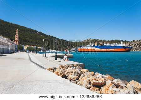 Greece, Panormitis-July 14 2014: The monastery, promenade, ferry berth on July 14, 2014 in Panormitis, Greece