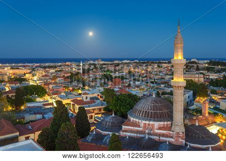 Greece, Rhodes - July 12 Panorama of the Old Town and the Mosque of Suleyman evening with the moon on July 12, 2014 in Rhodes,