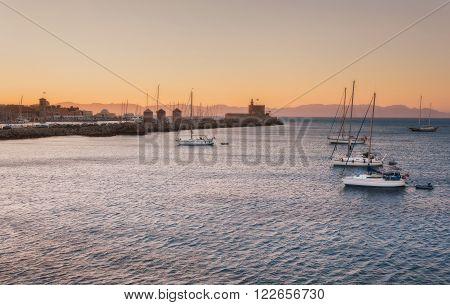 Yachts at sunset in the Mediterranean Sea near the Mandraki harb