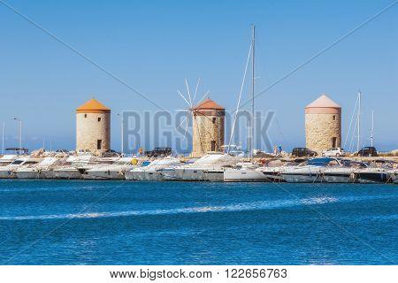 Greece, Rhodes - July 12 Windmills at Mandraki Harbour on July 12, 2014 in Rhodes, Greece
