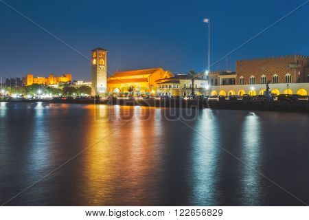 Greece, Rhodes - July 11 Quay at the port of Mandraki on July 11, 2014 in Rhodes, Greece