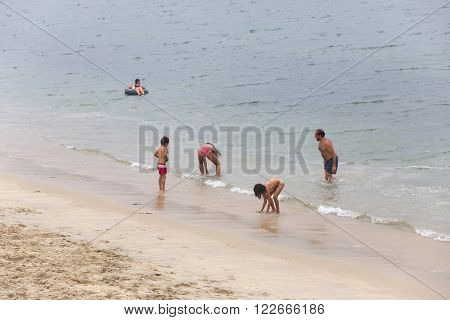 BAIONA, GALICIA, SPAIN - AUGUST 26: people at the beach, on August 26, 2015 in Baiona, Galicia, Spain