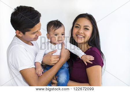 Young latin couple with a six month baby