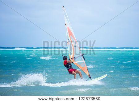 Boracay island, Philippines - February 08: windsurfer enjoying wind power on Bulabog beach on February 08, 2016, Boracay island, Philippines.