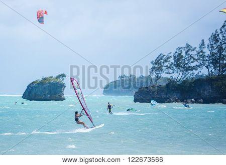 Boracay island, Philippines - January 25: windsurfers and kiteboarder enjoying wind power on Bulabog beach