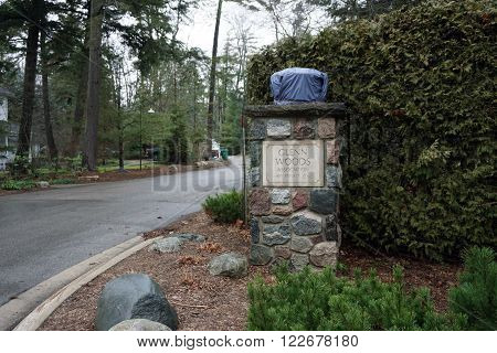 HARBOR SPRINGS, MICHIGAN / UNITED STATES - DECEMBER 23, 2015: An ornamental pillar marks the entrance to the private Glenn Woods Association in Harbor Springs, Michigan.