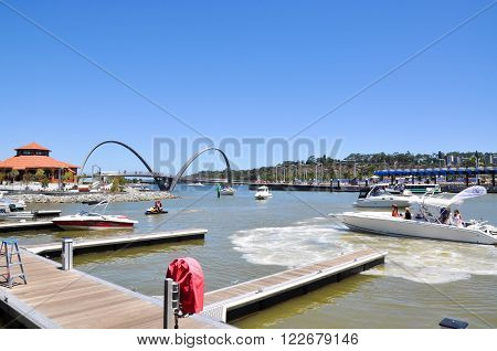PERTH,WA,AUSTRALIA-FEBRUARY 13,2016: The Elizabeth Quay development with artificial inlet and docking area, pedestrian suspensions bridge and boating on the Swan River in Perth, Western Australia.