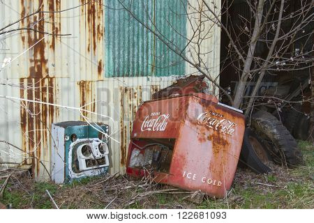 Columbia VA USA - March 12 2016: Antique Coca Cola vending machine outside metal shed.