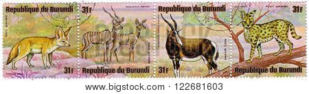 BURUNDI - CIRCA 1975: A stamps printed by Burundi shows Animals Burundi as Felis Serval, Lesser Kudus, White-fronted hartebeest (D. phillipsi) and Fennec, circa 1975.