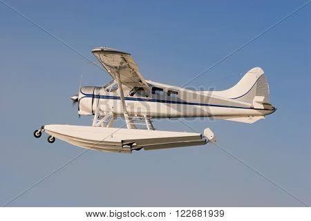 A Seaplane flying up in the air