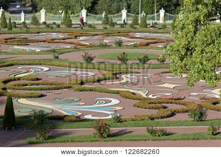 ORANIENBAUM, RUSSIA - AUGUST 29, 2015: People walking in the Oranienbaum garden. Founded in 1710-1727, it is listed as UNESCO World Heritage site
