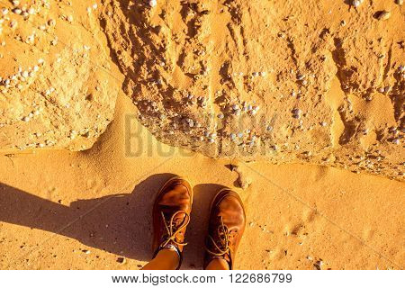 Standing on the dried riverbed with shells on Fuerteventura island in Spain