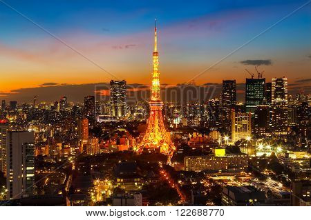 Tokyo Tower with Tokyo Cityscape in Twilight  TOKYO JAPAN - NOVEMBER 28 2015: Tokyo Tower built in 1958 it was the main source of antenna leasing and tourism over 150 million people visited the tower since its opening.