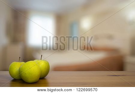 green apples on wooden table in the bedroom