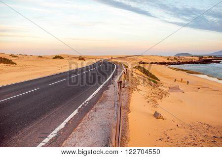 Sandstorm on the desert road on Corralejo dunes on Fuerteventura island in Spain
