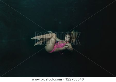 Young woman in a bathing suit under the water.