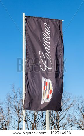 SAMARA RUSSIA - MARCH 20 2016: Dealership flag of Cadillac over blue sky. Cadillac Motor Car Division is a American premium car manufacturer