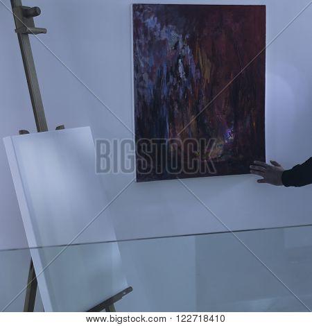 Photo of art thief with flashlight examining loot