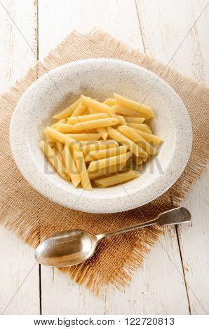 freshly cooked penne rigate on a plate