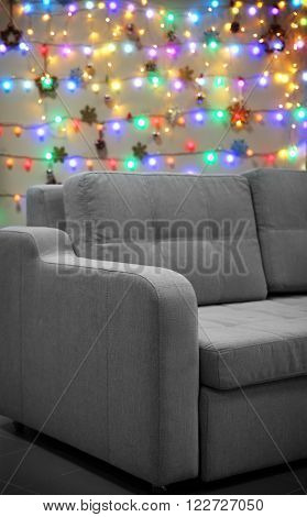 Grey couch on Christmas lights background