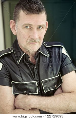 portrait of man wearing black fetish leather clothes