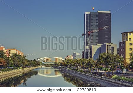 Bucharest, Romania - August 14, 2013: Picturesque city view with Dambovita river passing through Grozavesti district.
