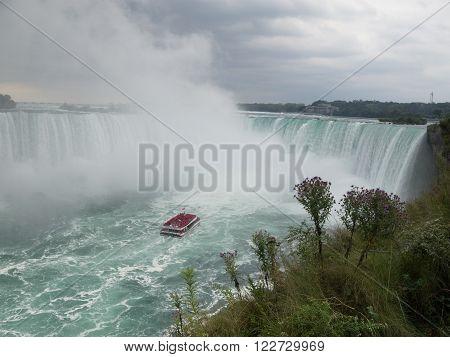 NIAGARA FALLS, ONTARIO, CANADA - September 19, 2015: The tourist boat  in Niagara Falls, Canada