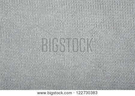 Wool Sweater Texture Close Up. Knitted Jersey Background With A Relief Pattern.
