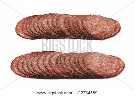 Stack of multiple salami sausage slices isolated over the white background, set of two different fore shortenings