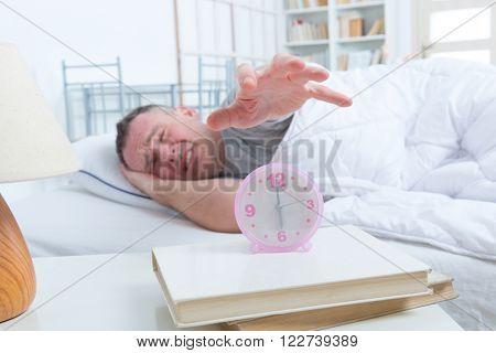 Sleepless, awaken man in bed at home