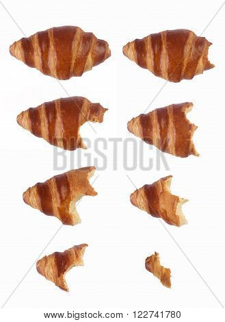 Vertical composition with the process of eating gradually a croissant isolated on white background