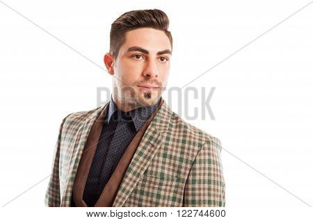 Fashionable and confident sales man posing with attitude on white background
