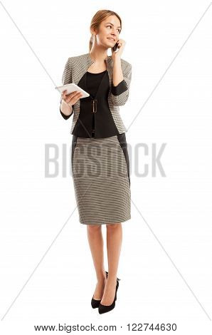 Confident Business Woman Talking On The Phone And Holding Tablet