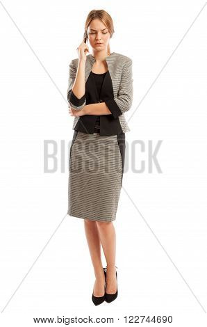Serious and worried business woman talking on the phone on white background