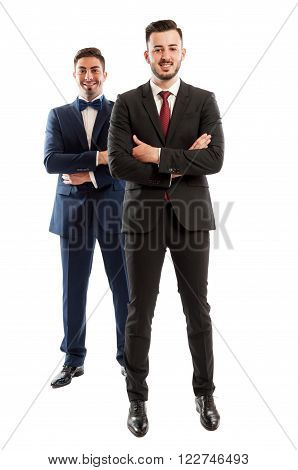 Confident business people standing and smiling on white background
