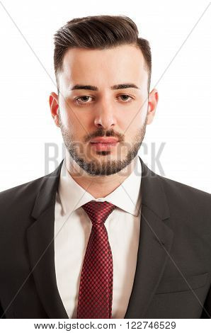 Portrait of a young and tired business man on white studio background