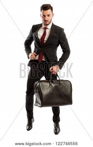 Elegant And Angry Sales Man Holding A Bag
