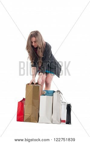 Attractive Female Customer Checking The Shopping Bags