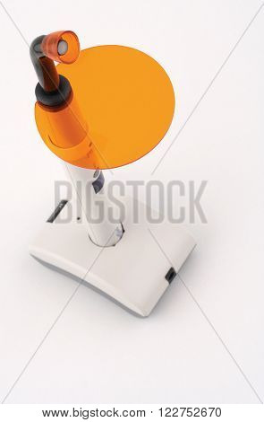 Vertical top view of an ultraviolet dentist lamp on white background