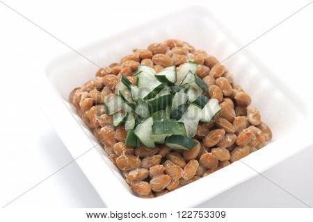 Natto, fermented soybeans with welsh onion on white background. (Japanese food) poster