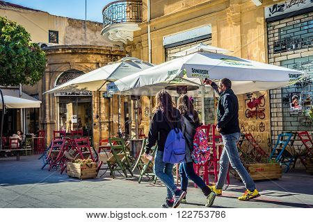 NICOSIA CYPRUS - DECEMBER 3: Tourists and local people walking on the charming vintage Fanairomenis street of old town in Nicosia on December 3 2015 in Nicosia.