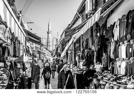 NICOSIA, CYPRUS - DECEMBER 3: People shopping at open-air market on Arasta street, a touristic street leading to Selimiye mosque in central Nicosia on December 3, 2015.
