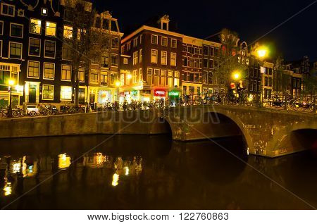 AMSTERDAM-APRIL 29: Red light district at night on April 29 2015. The red-light district is a part of city where prostitution is legal.