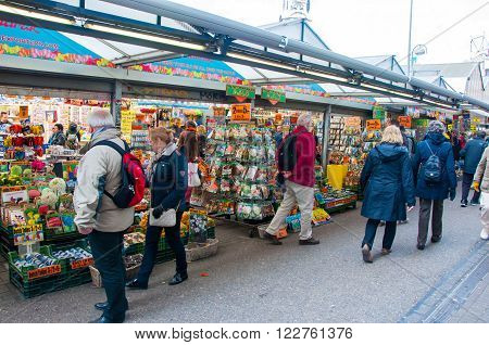 AMSTERDAM-APRIL 28: People buy houseplants and bulbs on the Amsterdam Flower Market on April 282015.The Flower market is one of Amsterdam most colourful attractions.
