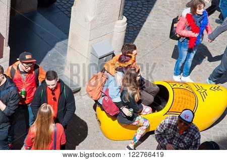 AMSTERDAMNETHERLANDS-APRIL 27: Locals and tourists have a fun on the street on King's Day on April 2727 in Amsterdam. King's Day is the largest open-air festivity in Amsterdam.