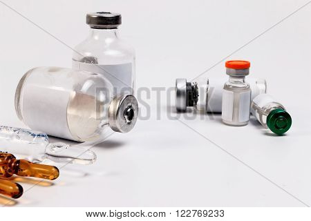 Medicine bottle for injection. Medical glass vial for vaccination. Science equipment liquid drug or vaccine from treatment flu in laboratory hospital or pharmacy. poster