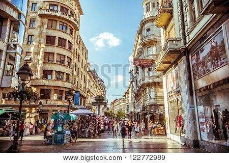 BELGRADE SERBIA - SEPTEMBER 23: Knez Mihailova Street on September 23 2015 in Belgrade Serbia. Street is the main shopping mile of Belgrade. Filtered photo with warm summer lighting.