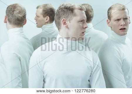 Duplicated image of man with mental illness, standing in light interior