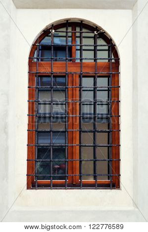 close up of a window with metal grill