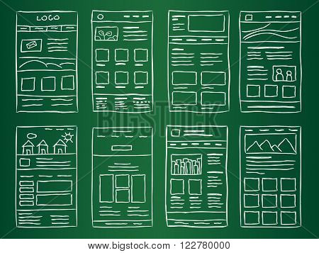 Hand drawn website layouts on green table